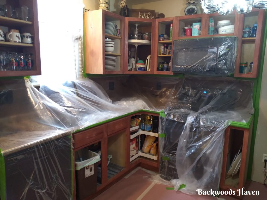 HOW TO PAINT KITCHEN CABINETS WITH NUVO PAINT KIT. COVER EVERYTHING WITH PLASTIC.