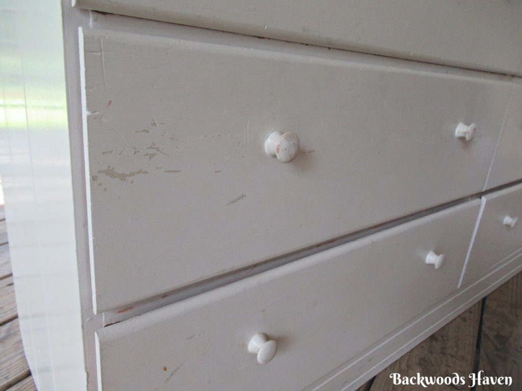 white chipping drawer fronts